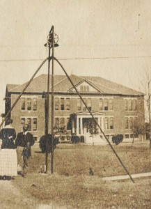 Ezekiel Robinson with the campus bell, 1910