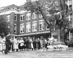 Wreath laying on Founder's Day in front of the McIver Memorial Building